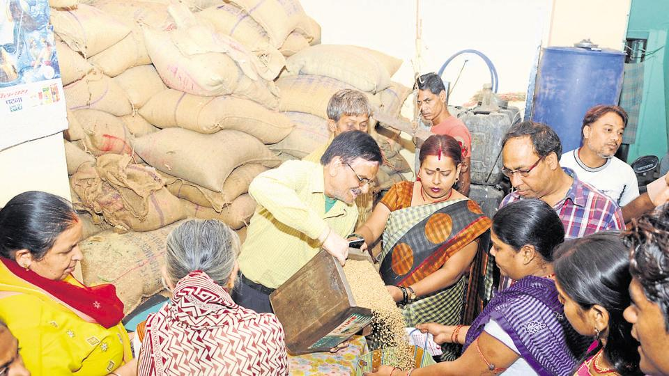 People buying food grain distributed through PDS shop in Ranchi , October 11, 2015.