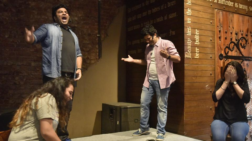 Comedians performs at the Hindustan Times Kala Ghoda Art Festival at the Irish House in Mumbai on Thursday.