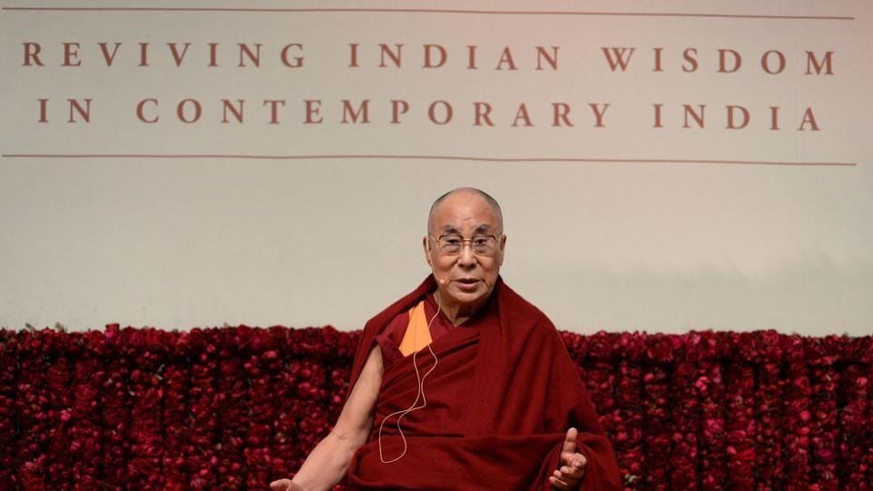 """Tibetan spiritual leader, the Dalai Lama, delivers a public lecture on """"Reviving Indian Wisdom in Contemporary India"""" at a function in New Delhi on February 5, 2017. / AFP PHOTO / SAJJAD HUSSAIN"""
