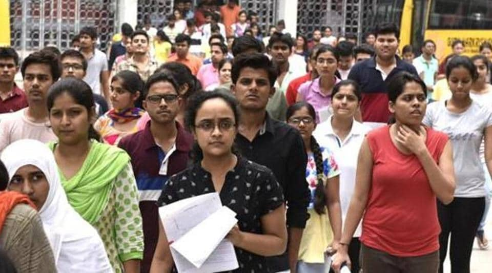 Students leave after appearing for an entrance exam in New Delhi in July 2016.