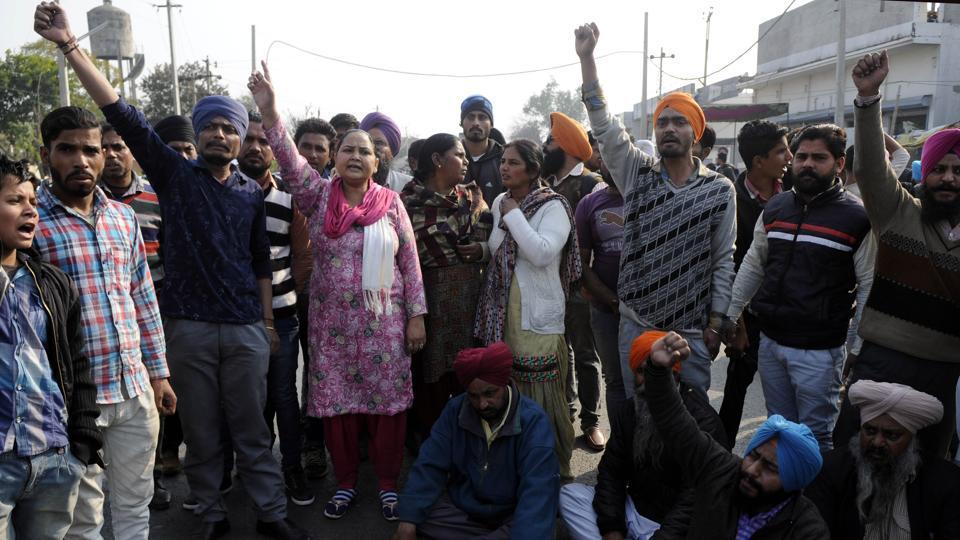 Bikramjit Singh's family members holding protest against Punjab police officials in front of police station Malerkotla in Sangrur district on Thursday.