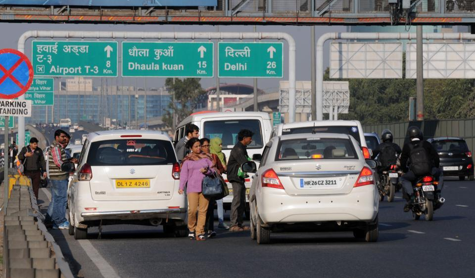 Commuters scramble for a ride on the Delhi-Gurgaon Expressway on a manic Friday.