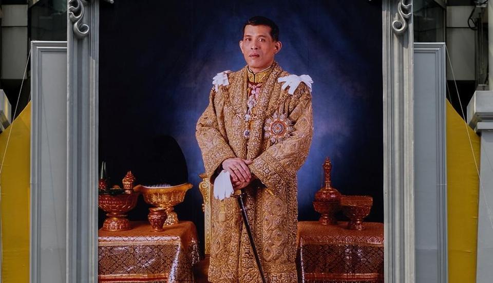 A man pays his respects to a portrait of Thailand's King Maha Vajiralongkorn Bodindradebayavarangkun at a department store in central Bangkok, Thailand.