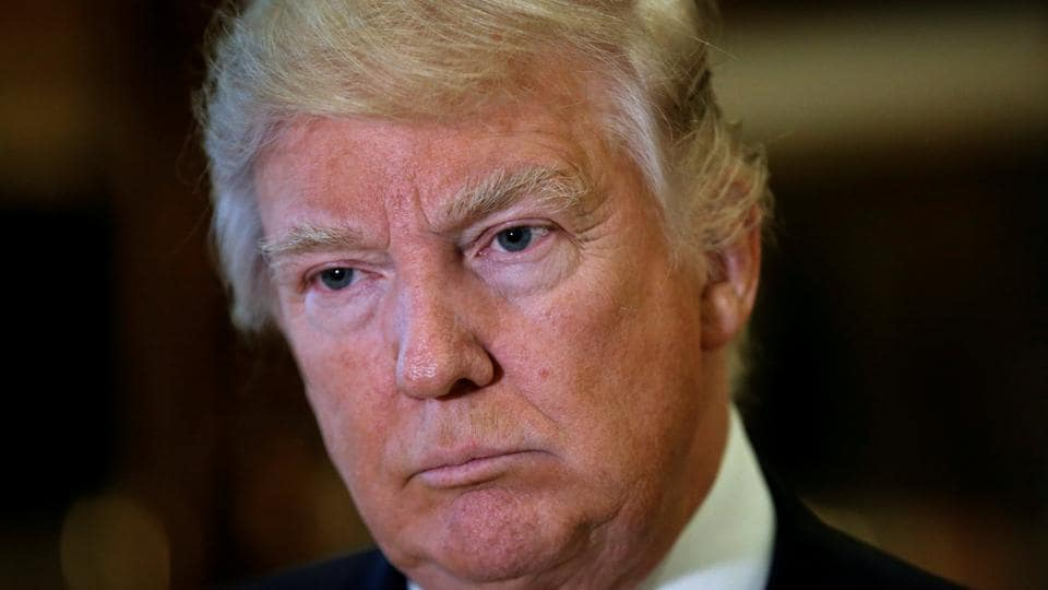 US President-elect Donald Trump listens to questions from reporters in New York.