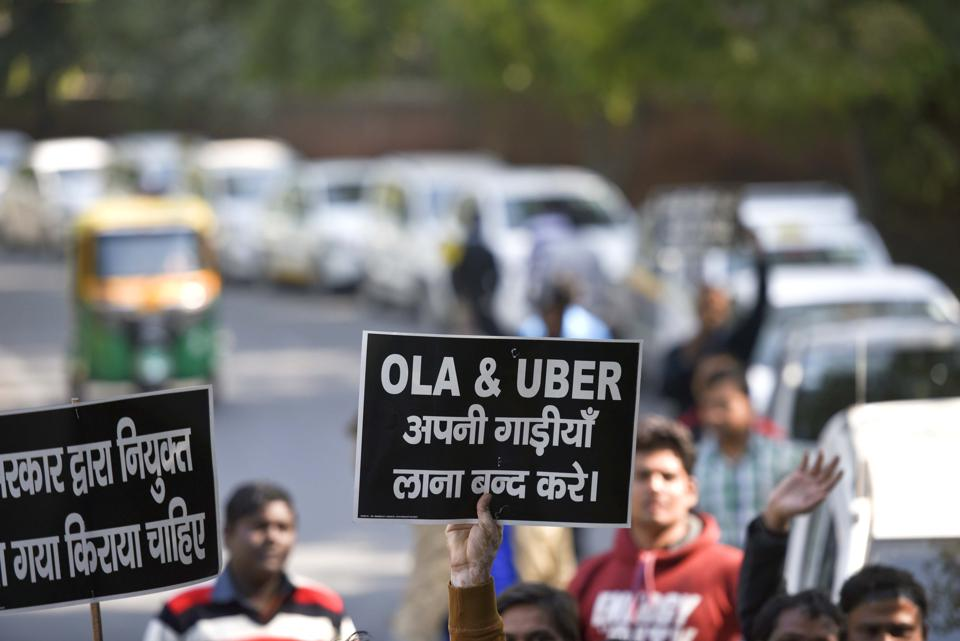 Hundreds of OLA-UBER drives protest for better rates at Jantar Mantar , in New Delhi.