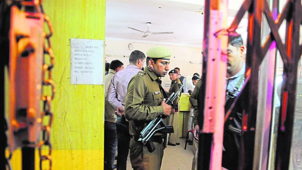 Gurgaon, India- February 09: Police officers investigate in Manappuram gold loan branch at new railway road, in Gurgaon, India, on Thursday, 09 February 2017. (Photo by Parveen Kumar/Hindustan Times)
