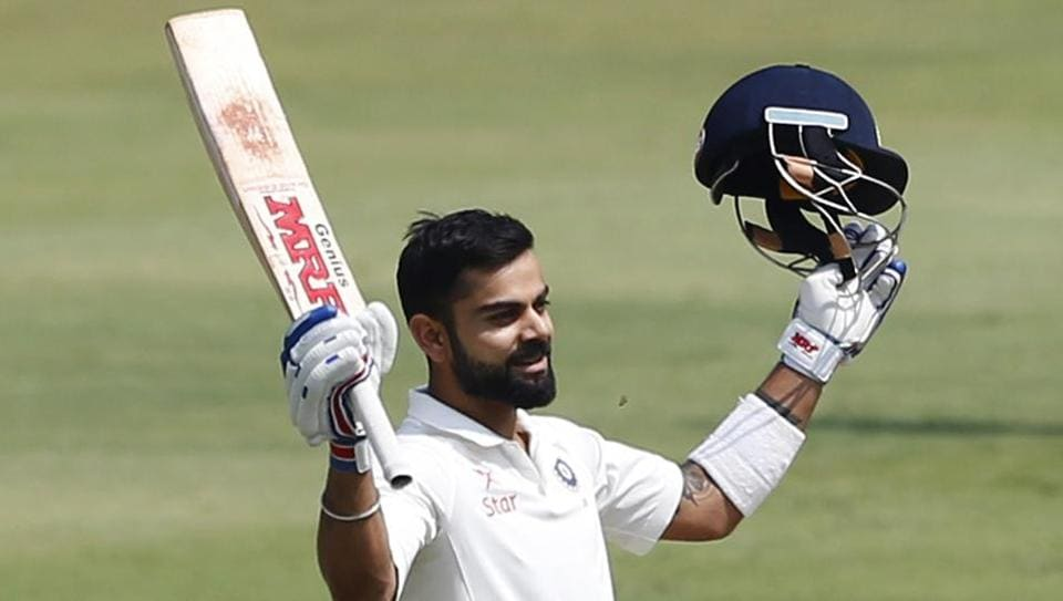 Virat Kohli raises his bat to celebrate his double century against Bangladesh in Hyderabad. He surpassed Don Bradman and Rahul Dravid by scoring double hundreds in four successive series. Bradman and Dravid in three.