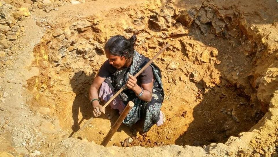 Sushila Khurkute digs to construct two toilets at Nandgaon in Palghar.
