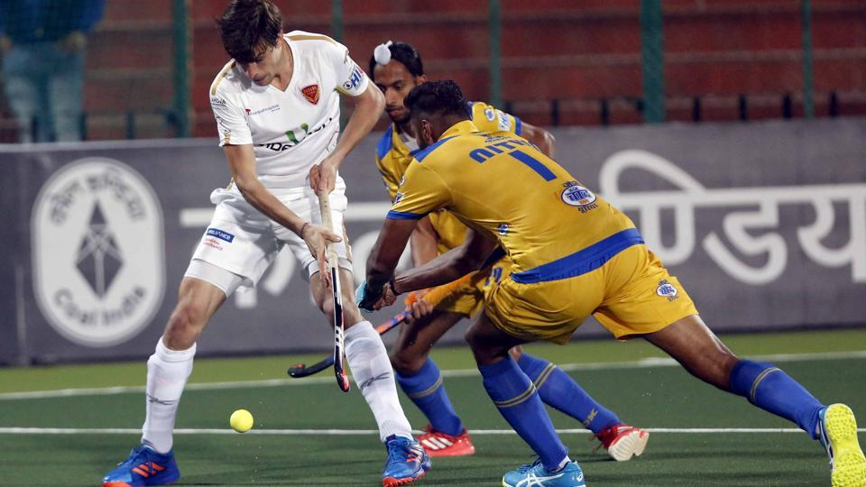 Dabang Mumbai and Punjab Warriors players vie for the ball during their Hockey India League (HIL)match in Chandigarh on Saturday.