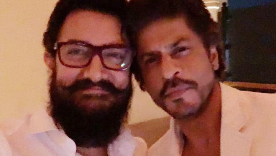Aamir and SRK were seen dressed in white which was seemingly the dress code of the party.