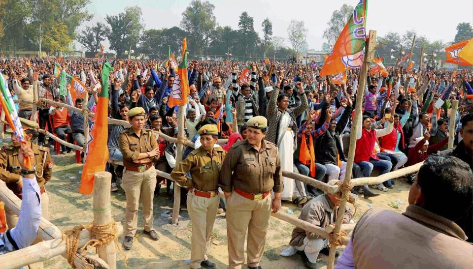 Securitymen and supporters at BJP national president Amit Shah's public meeting in Pilibhit on Saturday.