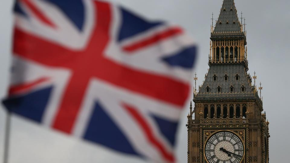 A Union flag flies near the The Elizabeth Tower, commonly known Big Ben.