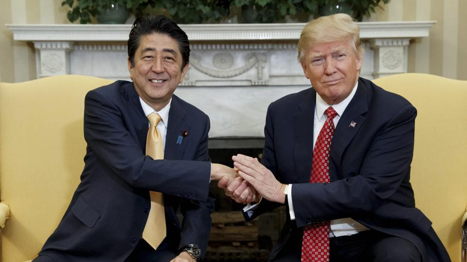 President Donald Trump shakes hands with Japanese Prime Minister Shinzo Abe in the Oval Office of the White House in Washington.