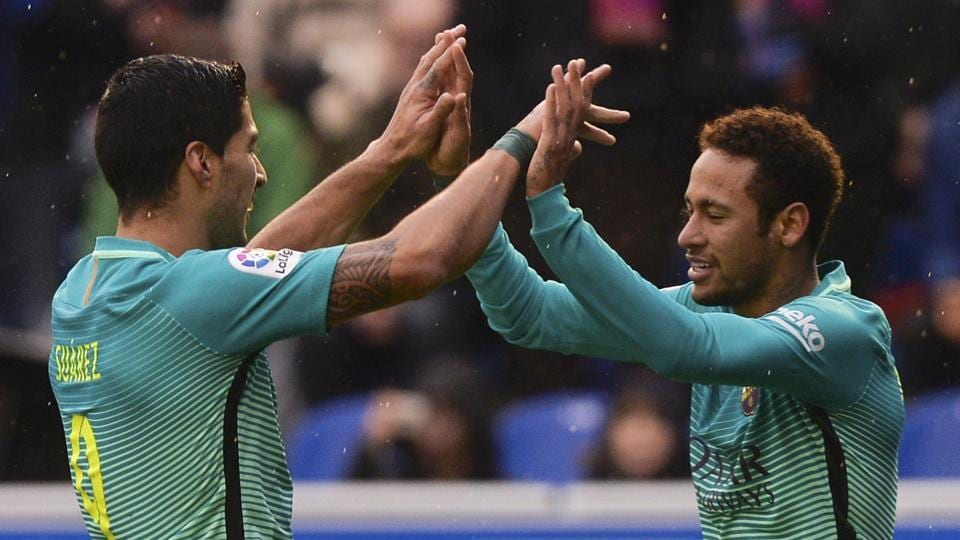 FC Barcelona's Luis Suarez and Neymar (R) celebrate scoring a goal against Deportivo Alaves in La Liga on Saturday.  REUTERS/Vincent West