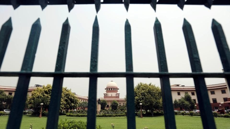 Supreme Court is pictured through a gate in New Delhi.