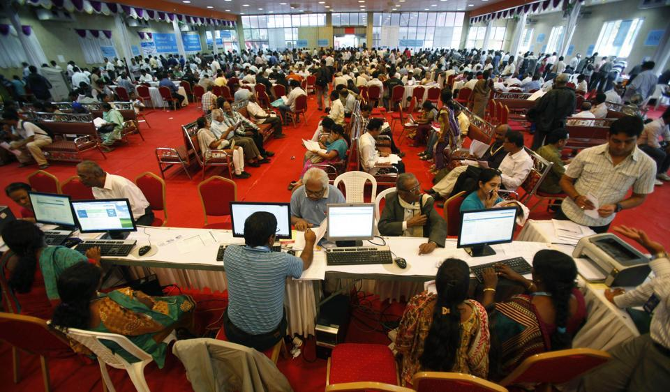 "Indian taxpayers wait to file their income tax returns at special counters set up by the income tax department in Bangalore. The tax department has urged it officers to ensure that honest and taxpayers are treated with ""dignity and courtesy""."