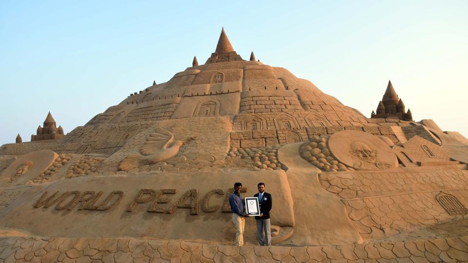 Sand artist Sudarshan Patanaik creates world's tallest sand castle at Puri beach.