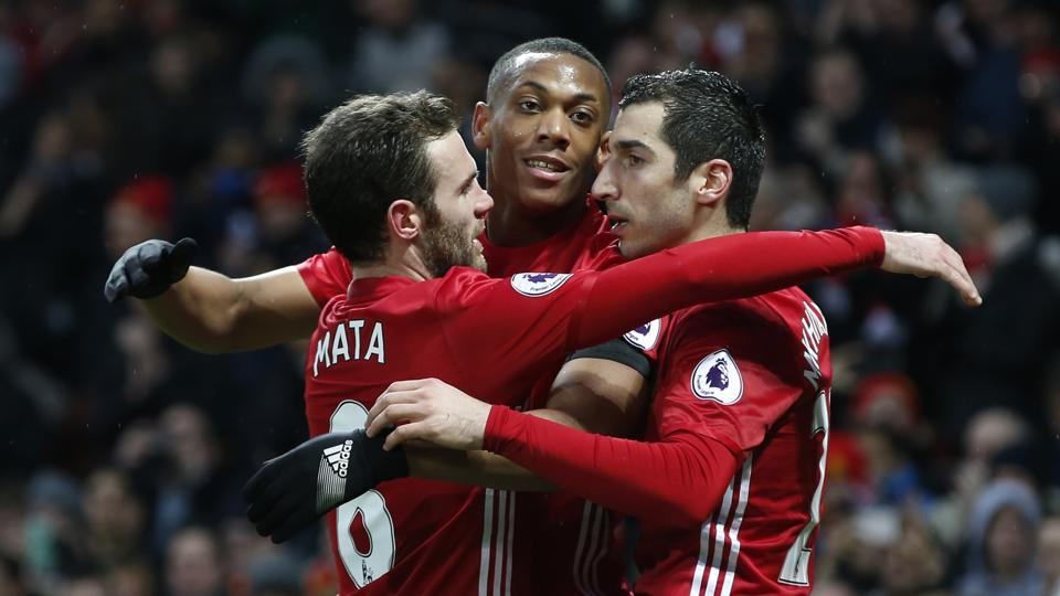 Manchester United's Anthony Martial (centre)celebrates scoring their second goal with Henrikh Mkhitaryan and Juan Mata, against Watford  on Saturday.