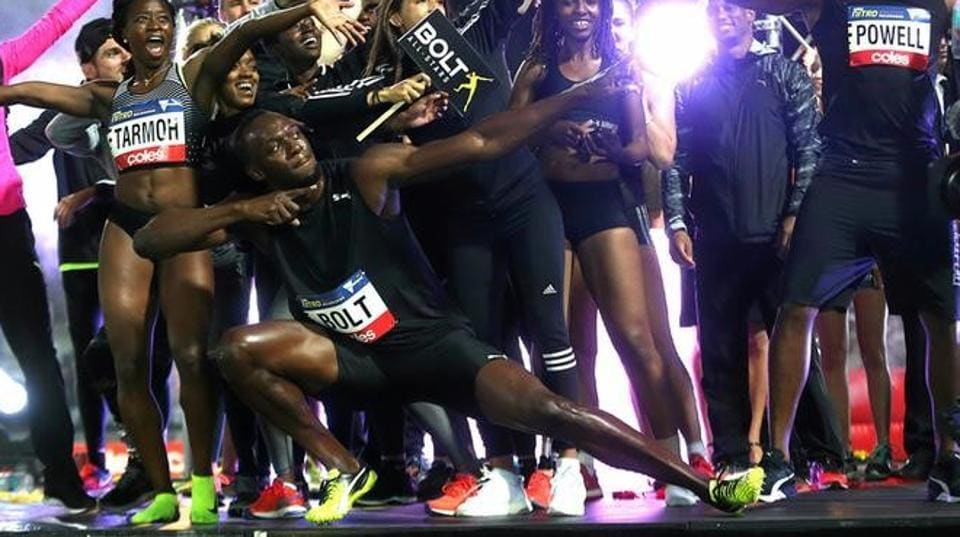 Usain Bolt, an eight-time Olympic champion, celebrates with teammates during the final night of the Nitro Athletics series at the Lakeside Stadium in Melbourne, Australia on Saturday.
