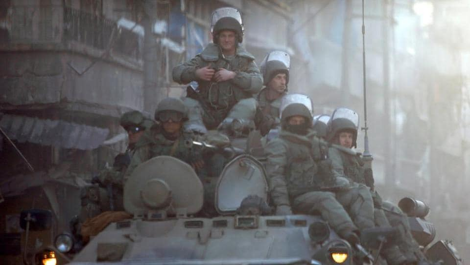 Russian soldiers, on armoured vehicles, patrol a street in Aleppo. Iran and Russia are closely cooperating in Syria and provide political, financial and military backing to the regime of President Bashar al-Assad.
