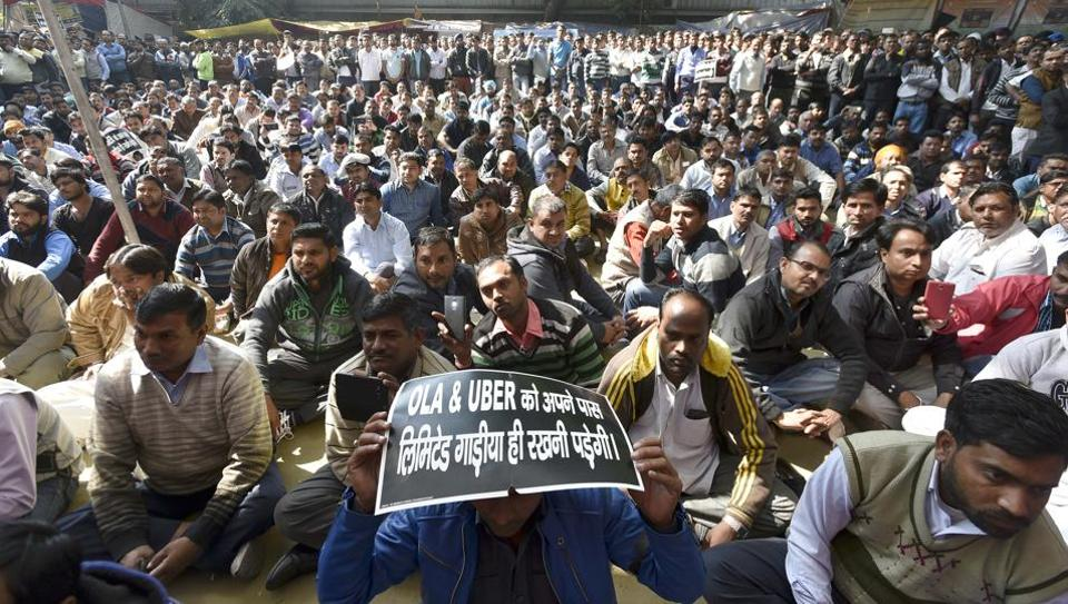 Hundreds of cab drivers on Friday staged a protest against cab aggregators Ola and Uber at Jantar Mantar and threatened a bigger strike from Monday if their demands were not met.