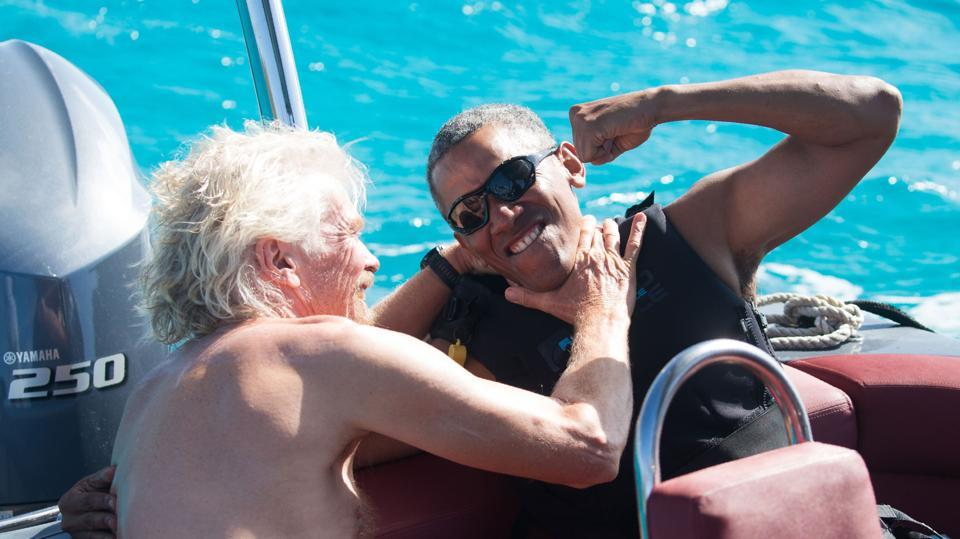In a recent handout picture released by Virgin on February 7, 2017, former US President Barack Obama (R) is pictured during a kitesurfing session with British billionaire Richard Branson (L), off the coast of Moskito Island in the British Virgin Islands in the Caribbean. (AFP)