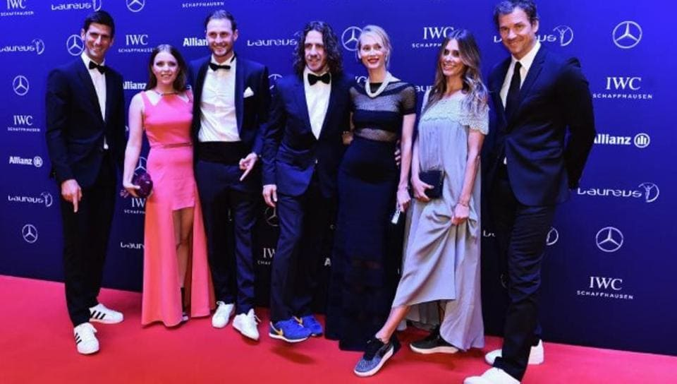 Novak Djokovic (extreme left), Carles Puyol (4th from left) at last year's Laureus World Sports Awards wearing sneakers.