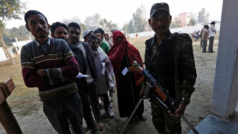 People queue up to cast their vote at a polling station in Uttar Pradesh.