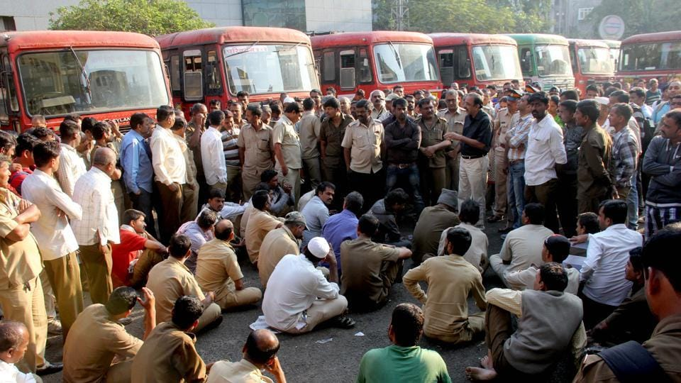 Officials talk to the MSRTC staff who were agitating against the death of driver, at the Mumbai Central depot, on Saturday.