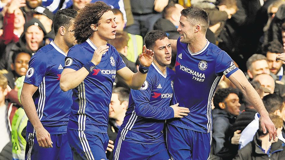 Chelsea Players celebrate after scoring a goal against Burnley.