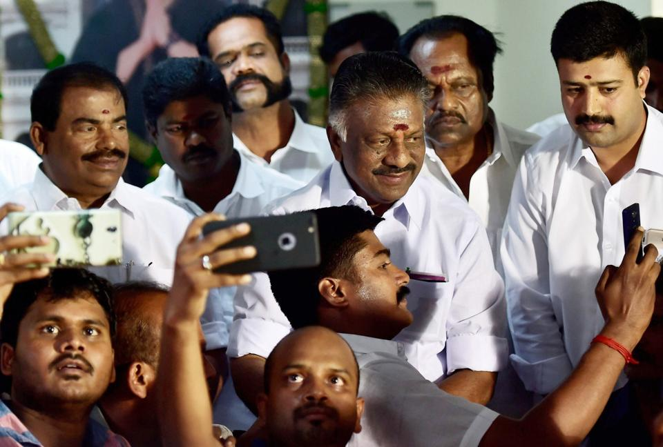 Tamil Nadu caretaker chief minister O Panneerselvam with supporters at his residence in Chennai on Sunday.