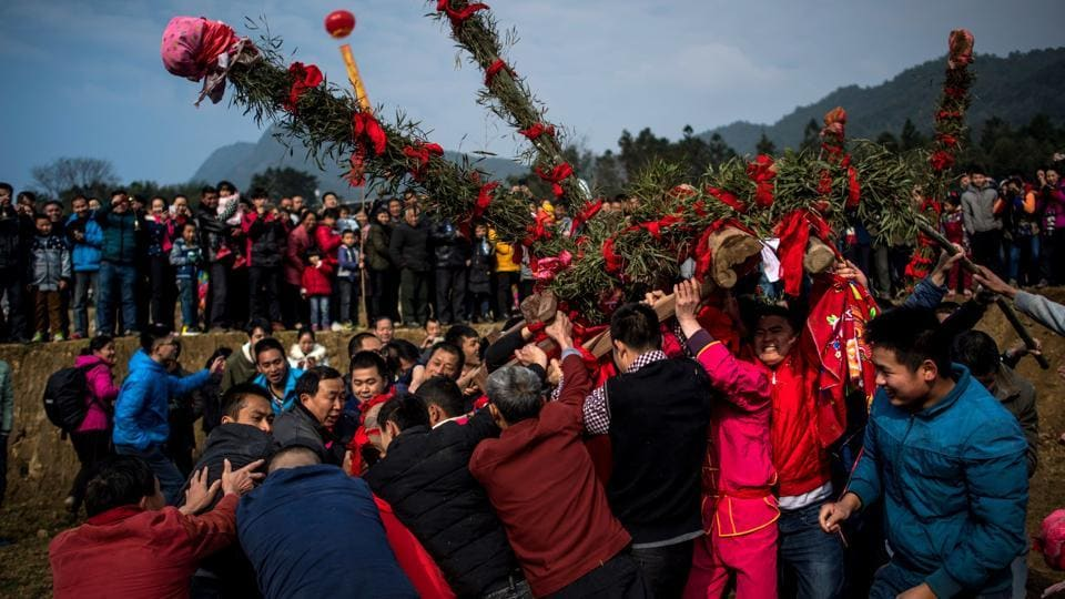 Villagers take part in the 'beat the Buddha' celebrations in Yuxi village. It is a time for colourful ceremonies in the coastal province, where the Hakka people have maintained folk traditions. (AFP Photo)