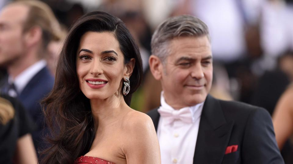 Actor George Clooney and his lawyer wife Amal Clooney attend the China: Through The Looking Glass Costume Institute Benefit Gala at the Metropolitan Museum of Art in 2015.