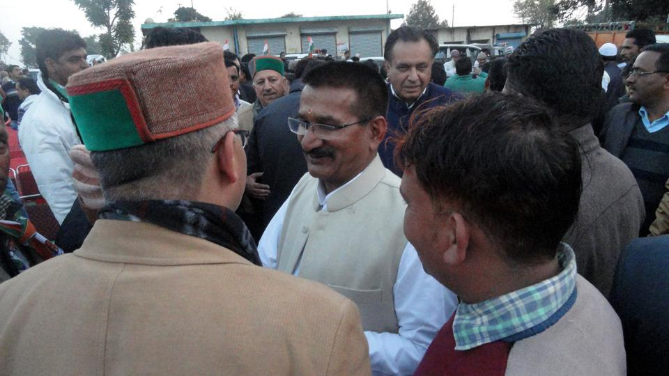 Congress candidate from Sahaspur constituency Kishore Upadhyay meets people at Kainchiwala.