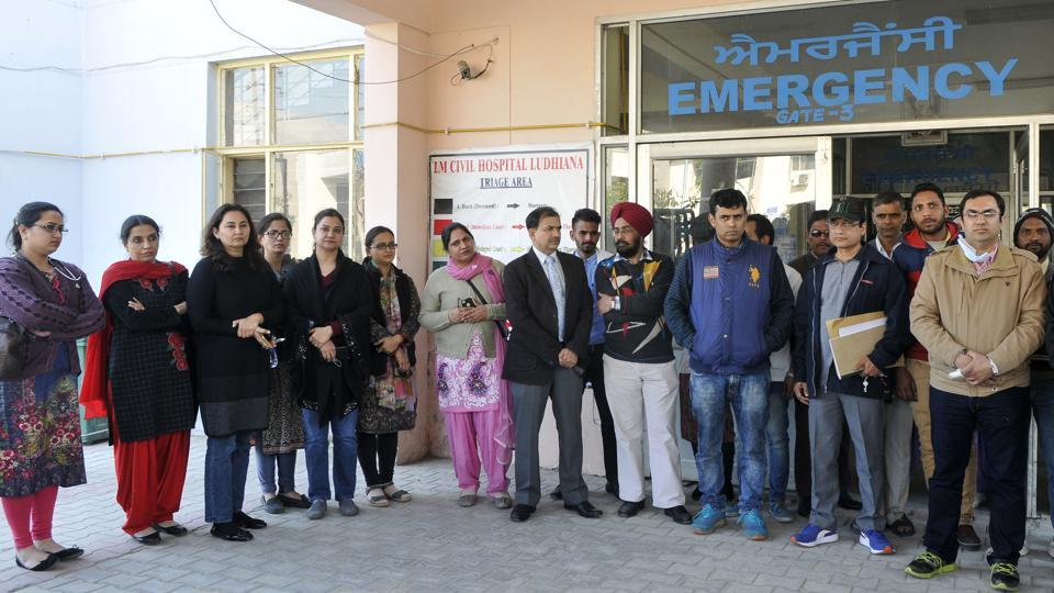 Doctors and staff protesting outside civil hospital in Ludhiana on Saturday.