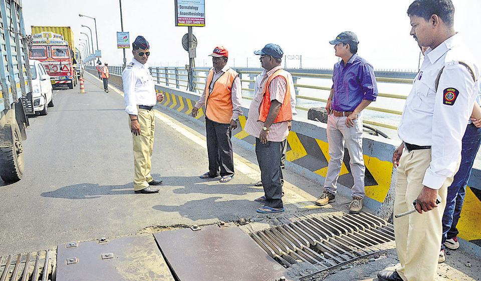 PWD officials fix a panel on the new Vashi creek bridge, for which the work commenced on February 3.
