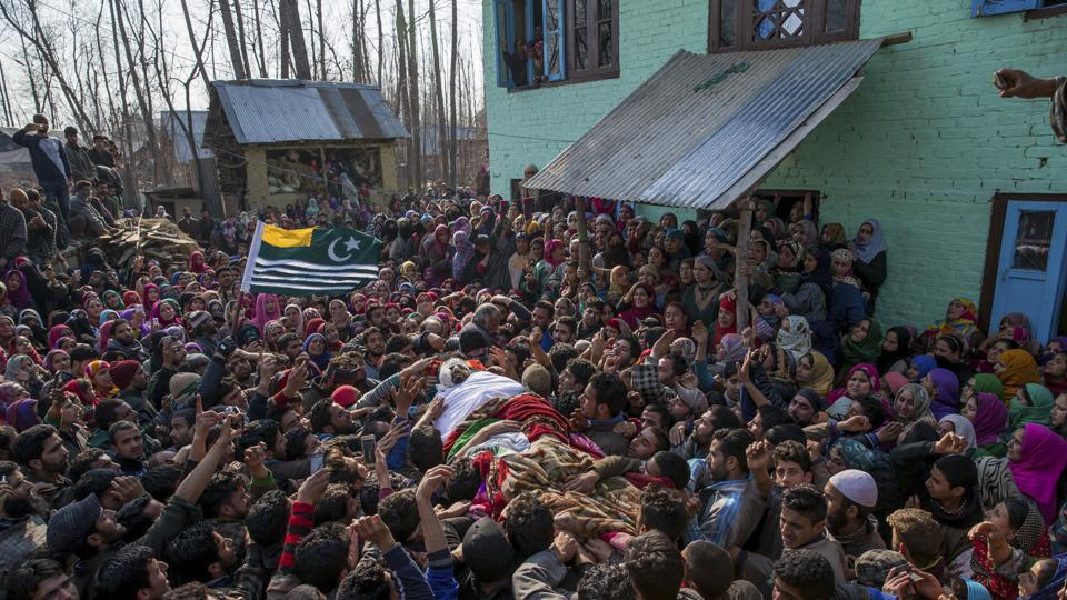 Kashmiri villagers carry body of Mudasir Ahmed, one among four suspected rebels killed at his residence in Redwani, 65 km south of Srinagar in Kashmir on Sunday.