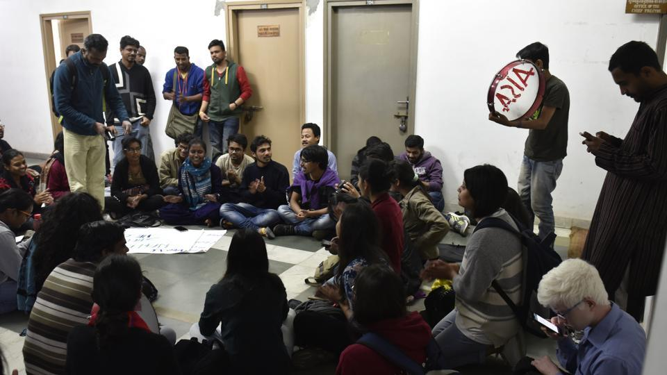 Students protest outside director admissions Milap Punia's office in the administrative block.
