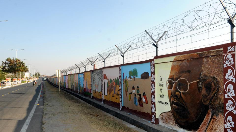 Boundary wall of the Birsa Munda airport painted with tribal art forms for the Global Investors summit