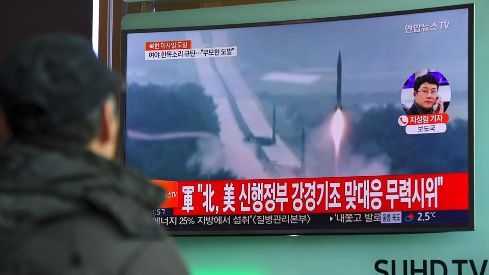 A man watches the news showing file footage of North Korea's missile launch at a railway station in Seoul.