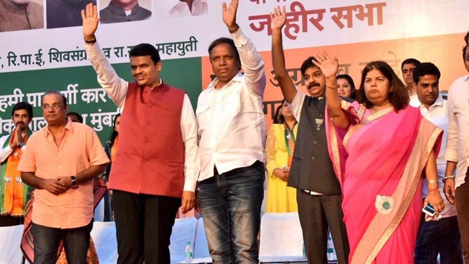 Chief minister Devendra Fadnavis (second from left), BJP's Mumbai chief Ashish Shelar (third from left) and other party leaders during a rally in Juhu on Sunday.