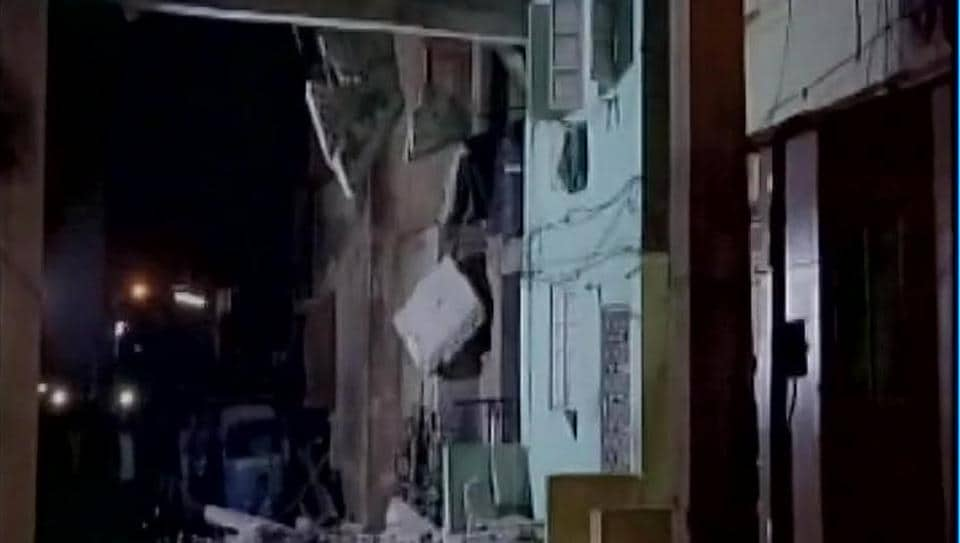Around 30 people had gathered under a slab connecting two tenements in Surat's Umarwada Colony when it came crashing down.