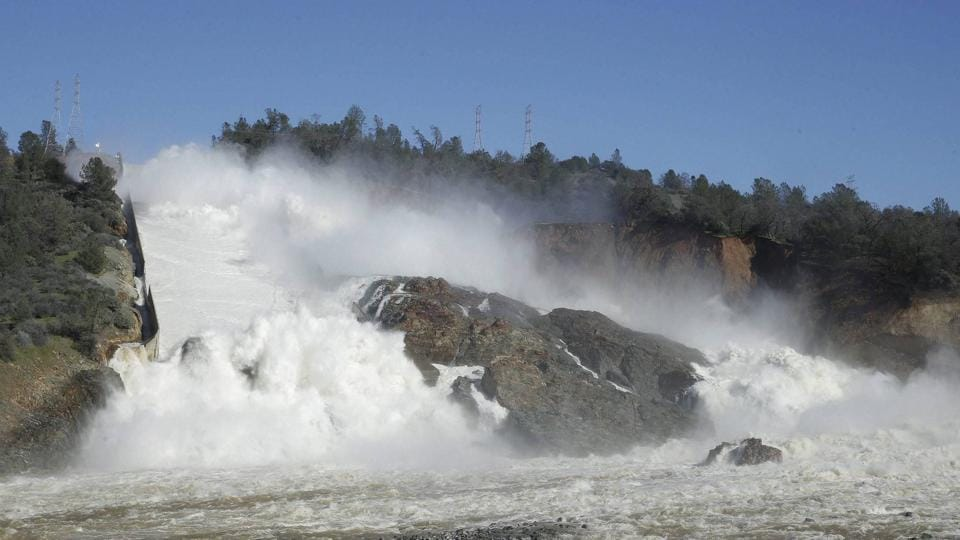 Water flows down Oroville Dam's main spillway, near Oroville.