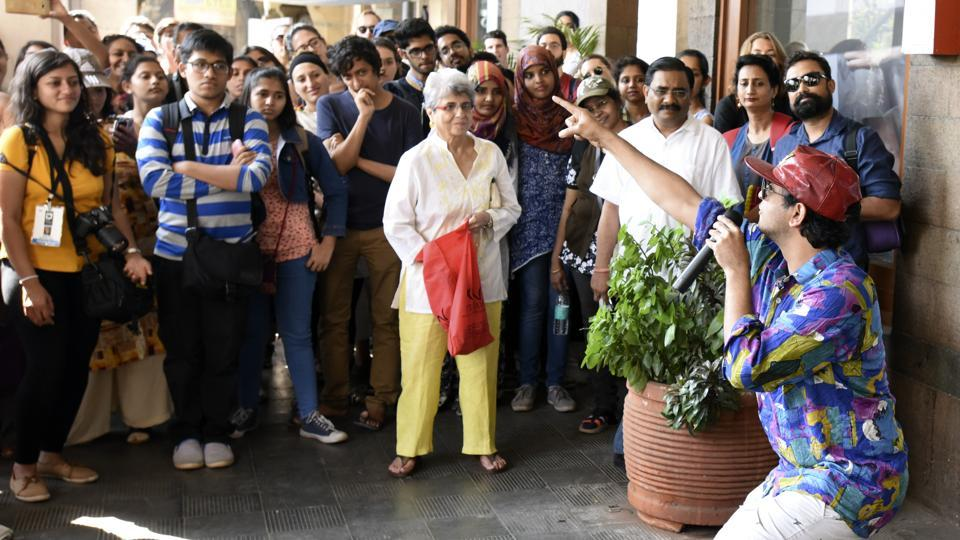 Participants watch actors during the HT Kala Ghoda Arts Festival heritage walk on Sunday.