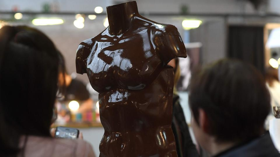 Visitors look at a chocolate creation in the shape of a torso on February 10, 2017 on the opening day of the Brussels Chocolate Fair in the Belgian capital, Brussels.  (EMMANUEL DUNAND / AFP)