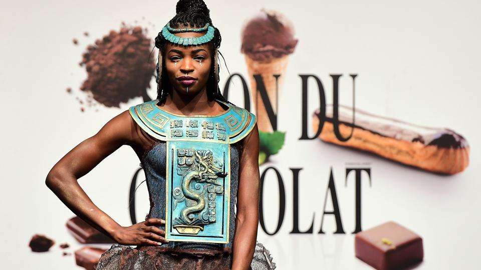 A woman dressed with a chocolate dress takes part in a show during the fourth edition of the Belgian Chocolate Fair (Salon du Chocolat) in Brussels on February 9, 2017.  (EMMANUEL DUNAND / AFP)