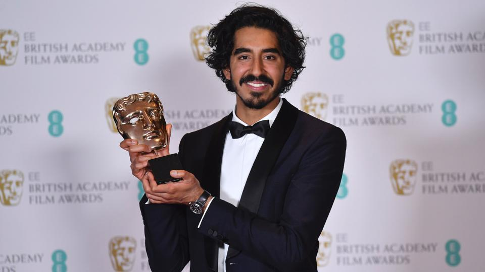 Dev Patel poses with the award for a Supporting Actor for his work on the film Lion at the BAFTA British Academy Film Awards at the Royal Albert Hall in London on Monday.  (AFP)