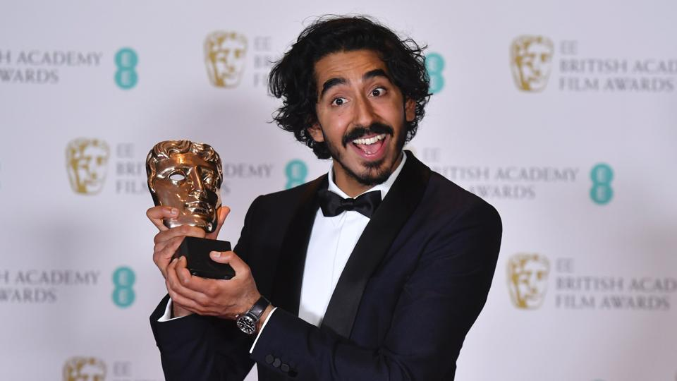 British Actor Dev Patel Poses With The Award For A Supporting Actor
