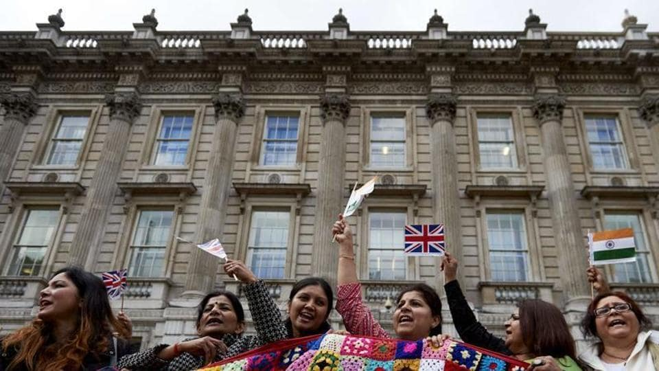 Supporters of Prime Minister Narendra Modi wave flags and cheer at a rally in Whitehall, London. (File photo).