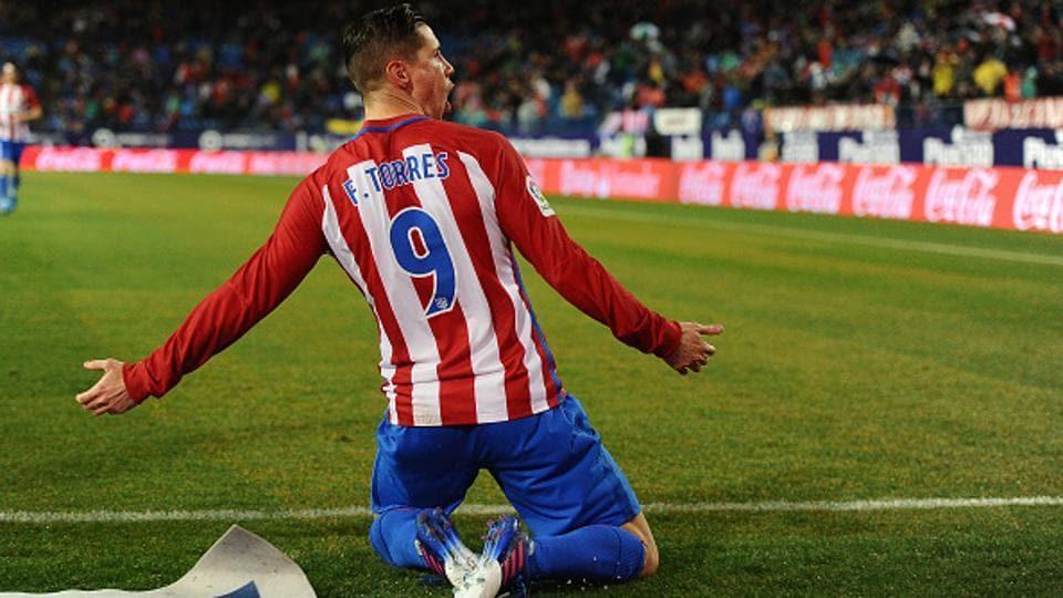 Fernando Torres,of Atletico de Madrid celebrates after scoring his team's first goal against Celta de Vigo.